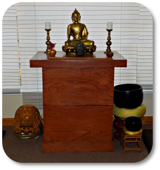 Photo of Clear Water Zen Center altar with bronze Buddha and candles.